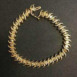 Złota bransoleta z diamentami - B470